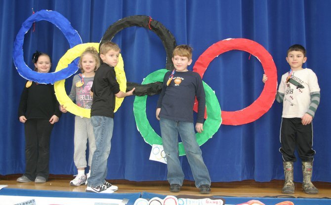 Keeseville Elementary students stand with their Olympic rings.