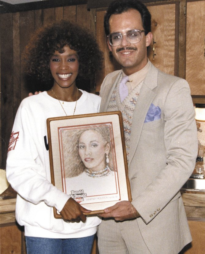 Manlius Mayor Mark-Paul Serafin is pictured with Whitney Houston at the 1986 New York State Fair. The portrait, which Houston signed, was part of a series of celebrity portraits done by Serafin and donated to the Ronald McDonald House of CNY.