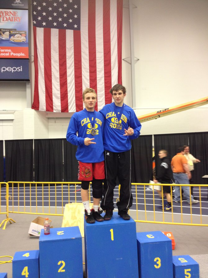 Cazenovia natives Aaron Benedict, left, and J.T. Romagnoli both won their second consecutive Section III Division I titles on Feb. 11 at Onondaga Community College's SRC Arena. Benedict and Romagnoli compete in the state meet in Albany this weekend.