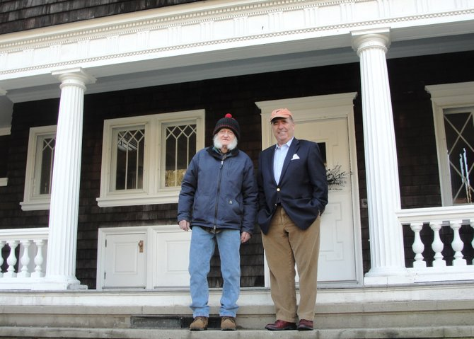 54Freedom CEO Jim Griffin, right, stands alongside Cazenovia resident caretaker Eddie Phethean in front of 54Freedom's national headquarters, located at 5 Ledyard Ave. in Cazenovia.