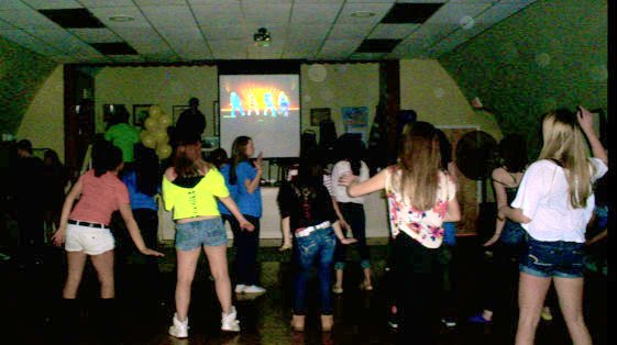 Attendees of the six-hour Second Annual Mucho Dinero dance move in unison while watching for the next position on a large monitor on Jan. 14 at the Cazenovia American Legion Hall.