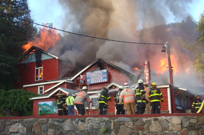 Firefighters from several area fire agencies battle a blaze in September 2009 in Warrensburg that destroyed the original Oscar's Smoke House, which was rebuilt soon after. Just this week, Warren County supervisors okayed a plan to build the initial building of a bicounty fire training center in Queensbury to help bolster the rosters of area fire companies as well as keep the skills of firefighters up-to-date.