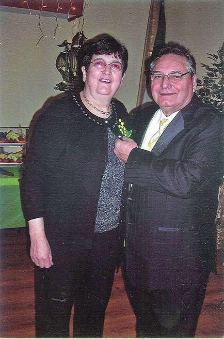 "Rotterdam Sons of Italy Lodge President Louis Fazzone gives a yellow mimosa flower to his wife, Antonietta, during last year's ""La Festa della Donna"" celebration, which honors female lodge members."