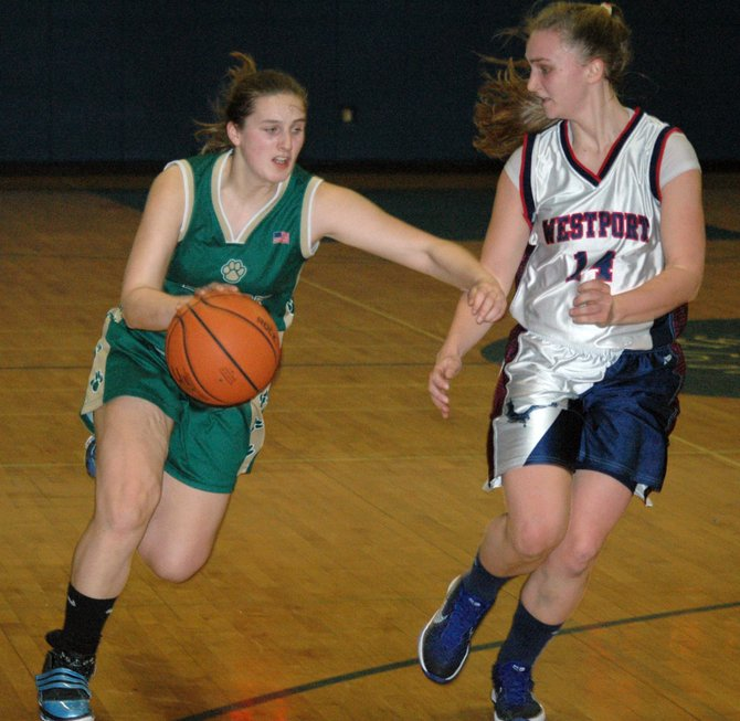 Lily Whalen of Elizabethtown-Lewis drives to the basket against Westport defender Willa McKinley.