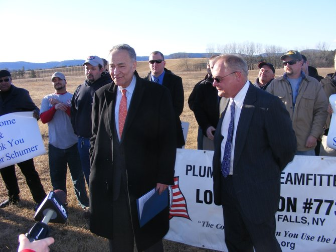 Backed up by steamfitters' union members, U.S. Sen. Charles Schumer (left) talks at a press conference Monday Feb. 20 about how he'll be lobbying for a federal grant of $750,000 to $1 million to bankroll technical training in hazardous materials cleanup, to be offered at the union's training center soon to be constructed in Tech Meadowsindustrial park in Queensbury. Glens Falls Mayor Jack Diamond (right), welcomed Schumer to the city-owned park.