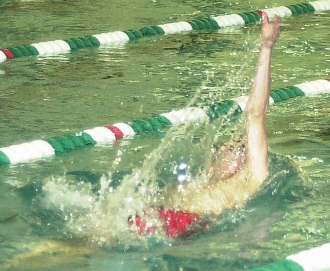 Bethlehem's Alex Lednev makes a splash during the backstroke portion of the 200-yard individual medley finals at last Saturday's Section II Division I championships at the Shenendehow Aquatic Center.