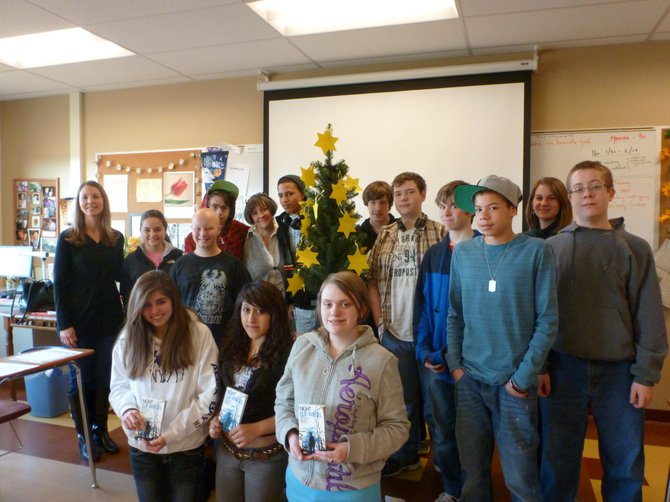 "Guilderland Central 10th grade English students stand with their ""Hope Tree"" after reading ""Night"" by Elie Wiesel."