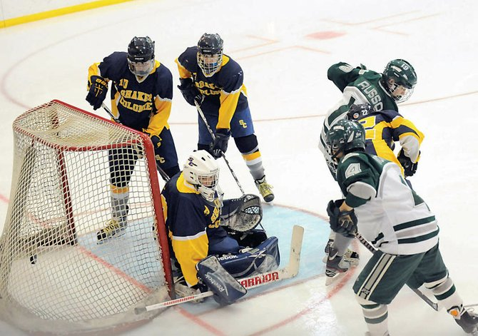 Shenendehowas Brandon Mortka (4) scores the first goal in last Fridays Section II Division I semifinal game against Shaker/Colonie at the Clifton Park Arena. The Plainsmen pulled away for a 9-2 victory.