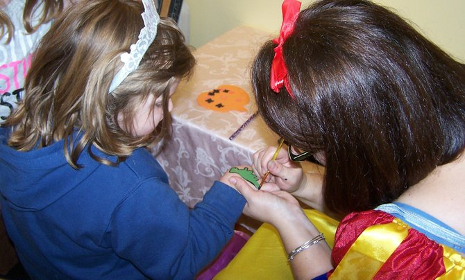 Entertainment at The Tiny Tots Tea Room includes face and hand painting.