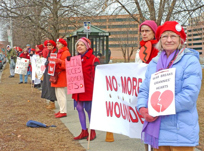 Members of Grannies for Peace demonstrate outside of the Albany Stratton VA Medical Center on Valentine's Day 2012.