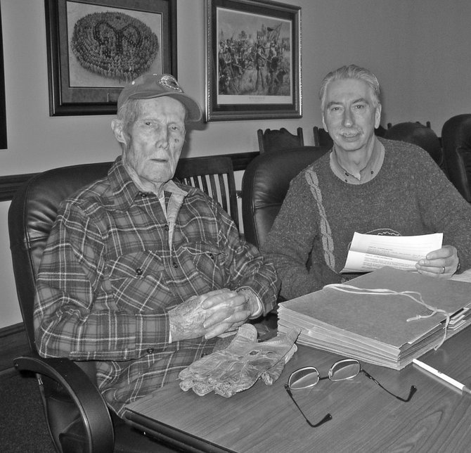 WorldWar II Veteran Charles Evans, left, with Wayne Clarke from the New York State Military Museum. Evans, 94, recently recorded the 2,000th oral history to be entered into the museum's project.