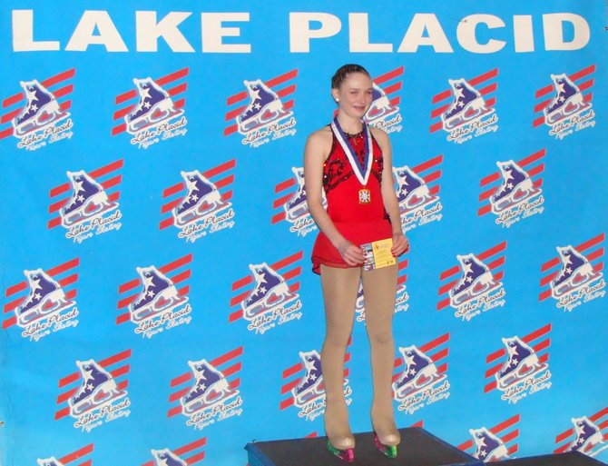 Kate Frost, of Cazenovia, poses with the gold medal she received for her free state program during the Empire State Games, Feb. 2 through 5 in Lake Placid.