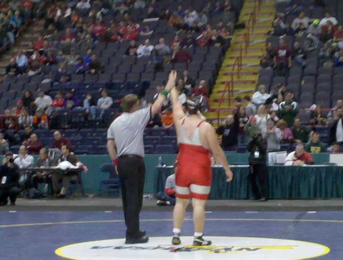 Beekmantown's Hayden Head has his arm raised as NYSPHSAA state champion at 285-lbs. Saturday, Feb. 25.