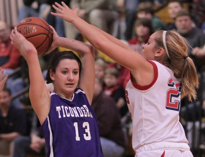 Ticonderoga's Kylie Austin looks to make a pass as Moriah's Lauren Pelkey applies defensive pressure. Moriah advanced to the Section VII Class C girls basketball tournament championship game with a 40-25 win against Ticonderoga Feb. 23.