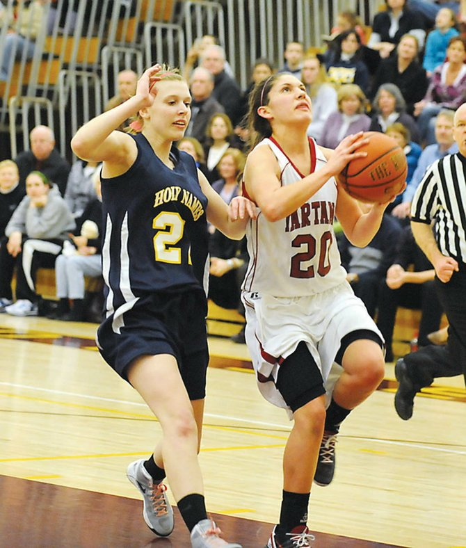 Scotia-Glenvilles Cassie Broadhead stays a step ahead of a Holy Names defender as she goes in for a layup during Tuesdays Class A semifinal game.