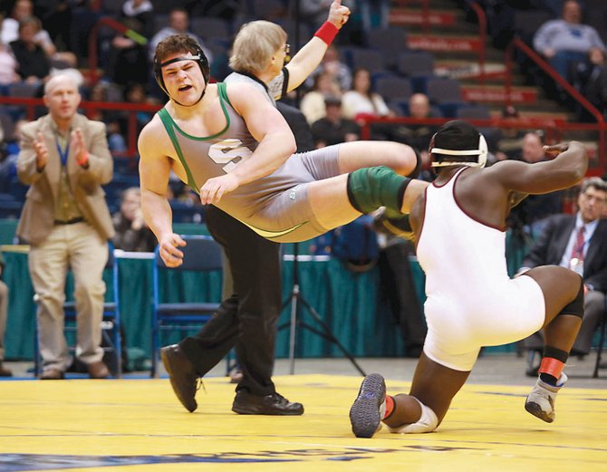Shenendehowa's Tony Fusco kicks out for an escape during his 195-pound championship bout against Johnson City's Reggie Williams at last Saturday's state tournament at the Times Union Center.