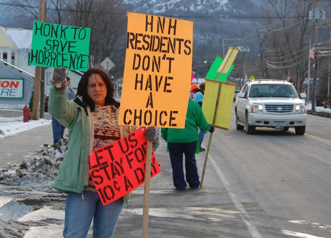 Lori Harter, a CNA at Horace Nye Nursing home, protests the privatization of Horace Nye nursing home alongside fellow nurses and community members Feb. 27 in Elizabethtown. 