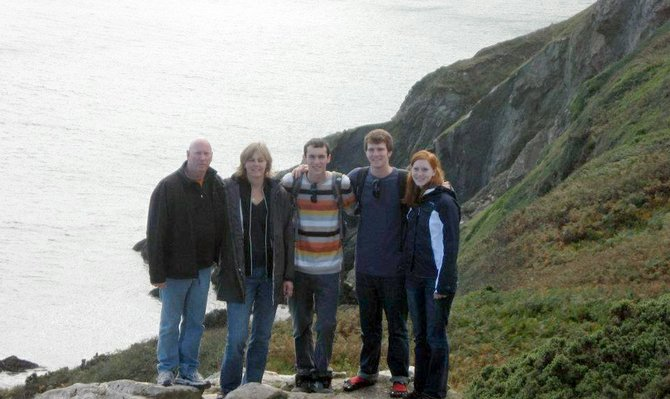 "Champlain College junior marketing/advertising major Tom Lyga, second from right, stands with his father Tom, left, mother Julie, brother Jon and sister Elaine at the cliffs in Howth, Ireland, earlier this fall. Lyga helped establish the Irish employment initiative ""Hireland"" while studying in Dublin from August to December 2011."