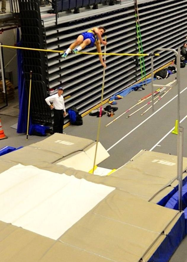 Dylan Muller of the Cazenovia Boys Indoor Track team soars over the pole vault bar at the State Qualifier Meet. His vault of 13 feet tied the school record and earned him a trip to the state championship.