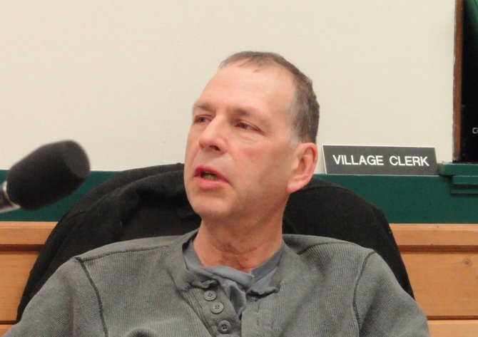 Tupper Lake Police Chief Tom fee speaks during a village board meeting.