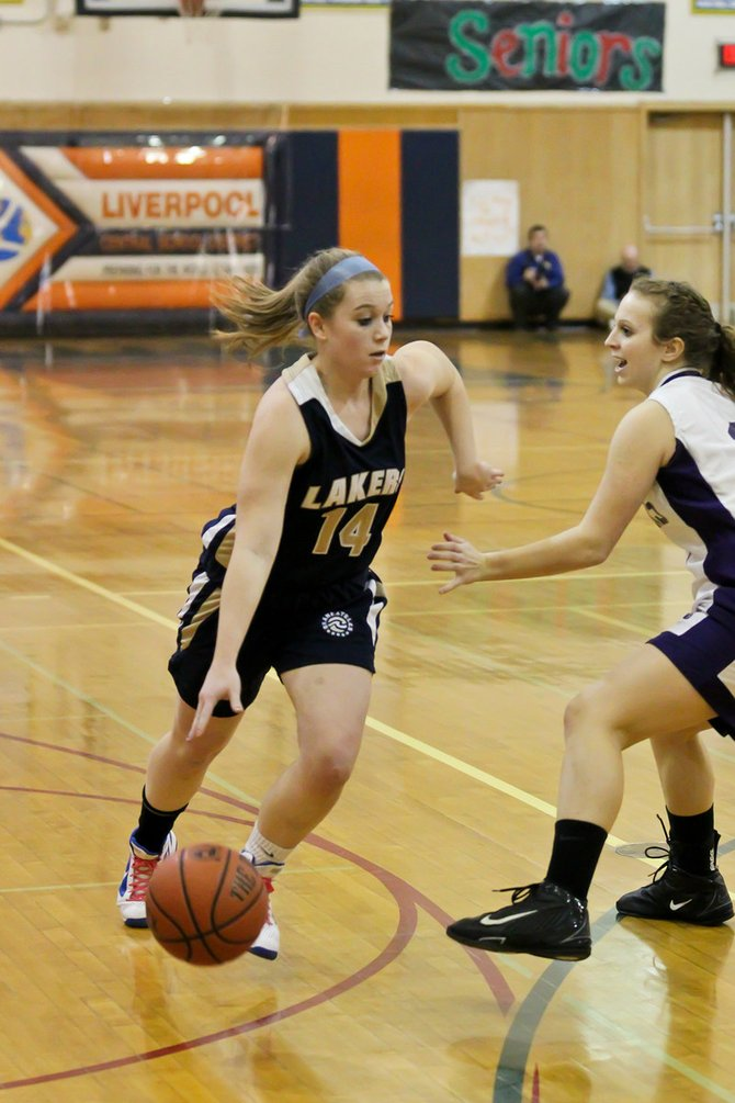 Skaneateles senior guard Emily Call (14) drives to the basket in Tuesday night's Section III Class B-1 final against Hannibal. Call had 18 points to lead the Lakers in a 64-51 loss to the Warriors.