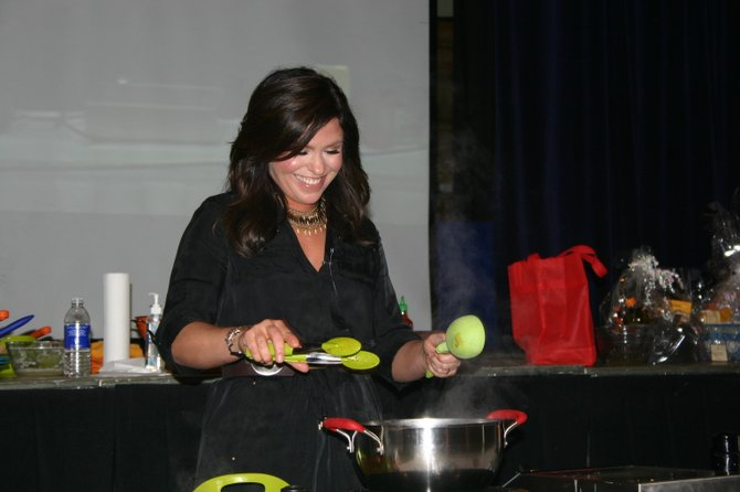 Rachael Ray reacts to a comment from the audience at Lake George High School during one of her recent annual appearances at her alma mater to meet and greet fans  as well as raise money for the school&#39;s alumni association. Tickets for the 2012 Rachael Ray Show in lake George go on sale Saturday March 10.