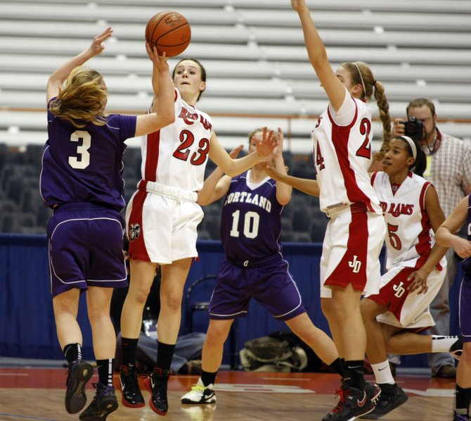 Jamesville-DeWitt guard Kayleigh Cavanaugh (23) blocks the shots of Cortland's Maggie Brown (3) in Thursday's Class A final. Cavanaugh, named tournament MVP, also had 13 points as the Red Rams, with a 47-38 win over the Purple Tigers, earned its first sectional championship since 1998.