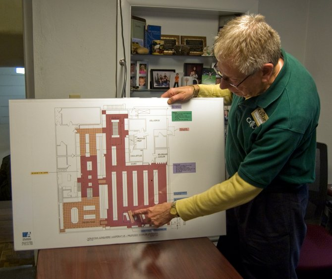 Donald Bisgrove, general manager for Niskayuna Co-op, shows off remodeling plans for flooring and other renovations at the supermarket.