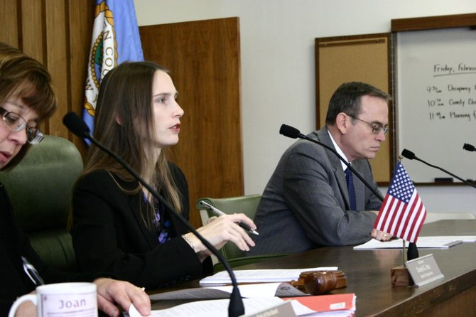 In mid-2011, Evelyn Wood (center) presides over a Warren County Planning & Community Development Committee meeting in mid-2012.  As  Wood announced her candidacy for state Assembly Sunday, she said her experience chairing this committee would be useful, if elected, in pursuing the objectives of economic development and job growth, particularly in the Adirondacks. County Board of Supervisors Clerk Joan Sady (left) and Warren County Administrator Paul Dusek (right) flank Wood as she conducts the meeting.