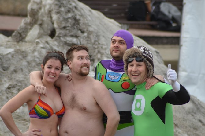 During Lake George Winter Carnival's final weekend for 2012, a group of polar swimmers relax on Shepard Park Beach before plunging into cold waters. About 65 swimmers, many in costumes, braved the waters of Lake George.
