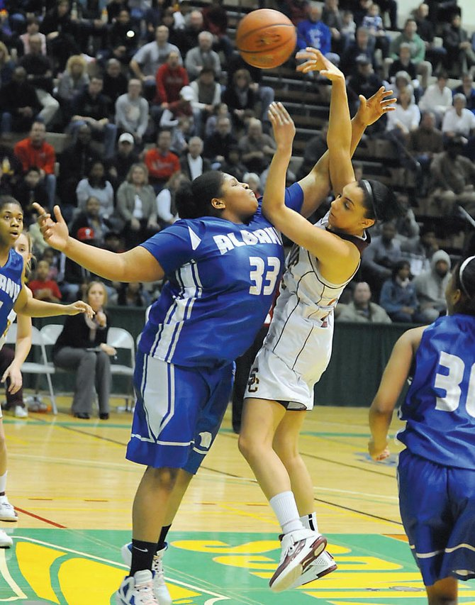 Colonies Sydnie Rosales is fouled by Albanys Melissa Canty during Saturdays Section II Class AA championship game at Hudson Valley Community College. 