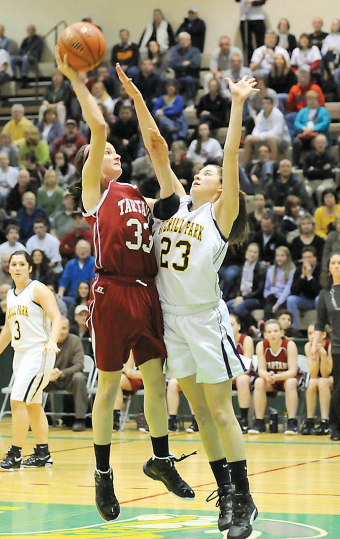 Scotia-Glenville's Sarah Janson (33) takes a shot over an Averill Park defender during Saturday's Section II Class A title game at HVCC.