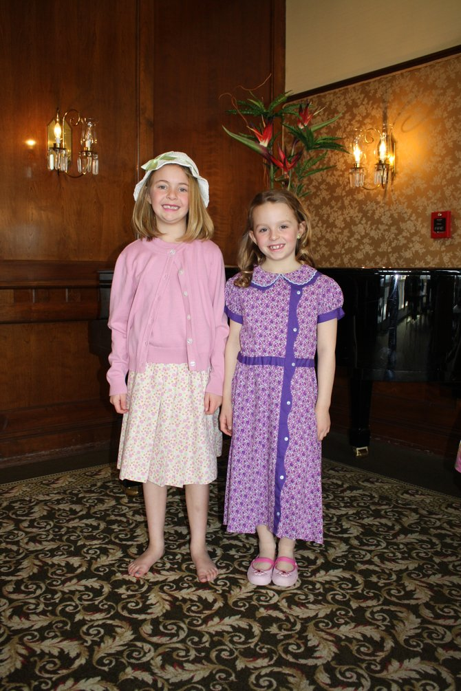Young models dress up as different American Girls for the American Girl Fashion Show, hosted by the Junior League of Albany.