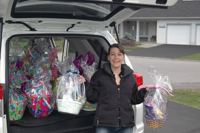 Lisa Morahan delivering baskets for the 2011 Project Easter Bunny. Donation boxes for goods that will go in baskets for this year are at various places in the community until March 26. 