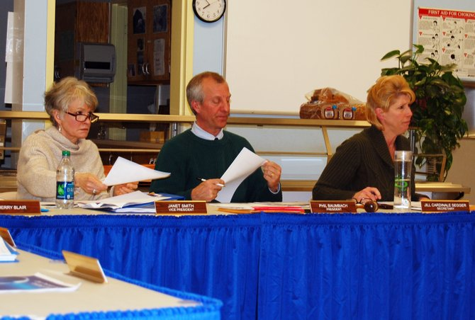 School board members, Janet Smith, Board President Phil Baumbach and Board Secretary Jill Cardinale Segger listen as Superintendent, Randy Richard's delivers his superintendent report at March 6 school board meeting.
