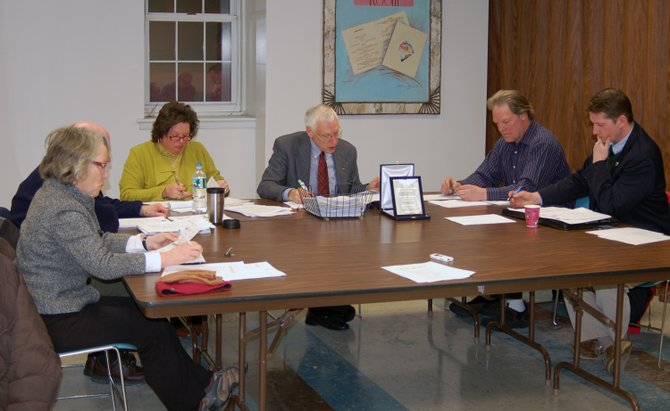 Members of the Lake Placid Village Board meet.