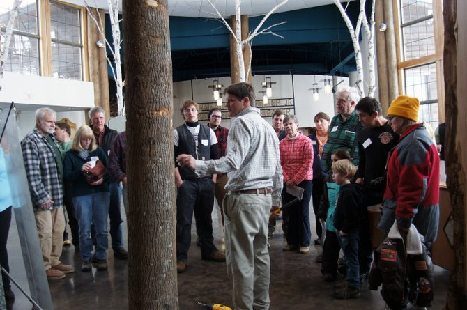 Mike Farrell, the Director of Cornell's Uihlein Field Station, explains the process of tapping a tree at the Wild Center in Tupper Lake.
