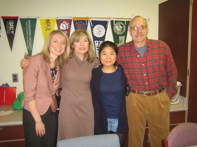 South Korean foreign-exchange student Bora Kang, second from right, stands with Hobart and William Smith Colleges representative Rebecca Arnold, left, and host parents Denise and Bill Theiss in November at Cazenovia High School.