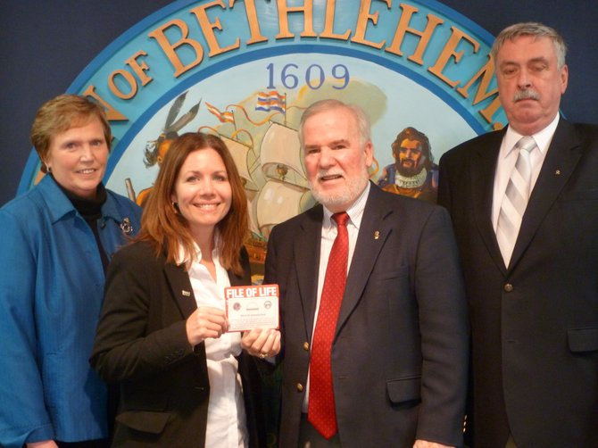 From left, Joyce Becker, Director of the Town of Bethlehem Senior Services Department, Karen Koster, Bethlehem Senior Projects, Inc. Board member, left, holds a File of Life with Bethlehem Lion's Club President Dan Ryan and Lion's Club member Mike Durant.