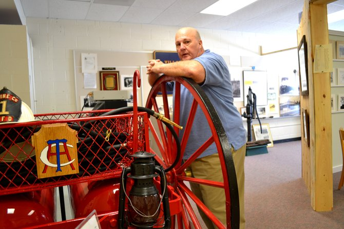 Pete Light and Eric Jarvis restored this soda-acid fire extinguisher for the Dannemora Village Museum, which has been open for about four months. Photographs, articles and exhibits bring the village's history to life.