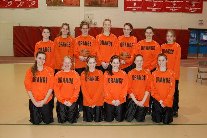 The Indian Lake-Long Lake Lady Orange players pose for a team picture March 10, 2012 at the Plattsburgh State Fieldhouse before a post-season game against Argyle. The Lady Orange lost 47-21.