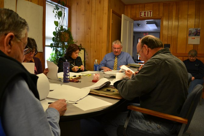 The Rouses Point board plans to cut $7,000 from their contribution to the Fourth of July fund to keep the tax levy flat for village.