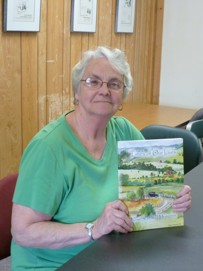 "Peg Dorgan with the  New Scotland Historical Association's newest book, ""Times of Ours Lives: New Scotland Memories."""