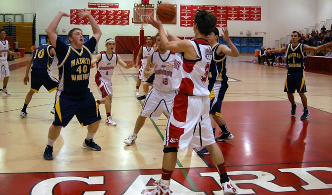 Clayton Cross looks to inbound the ball for Willsboro against the Madrid Waddington defense.