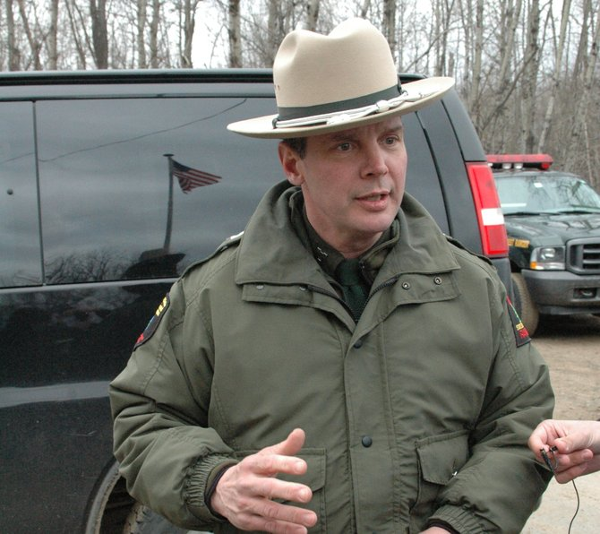 New York State Department of Environmental Conservation Forest Ranger John Streiff briefs media members at the Piercefield Highway Department on the third day of the search for 18-year old Collin Gillis.