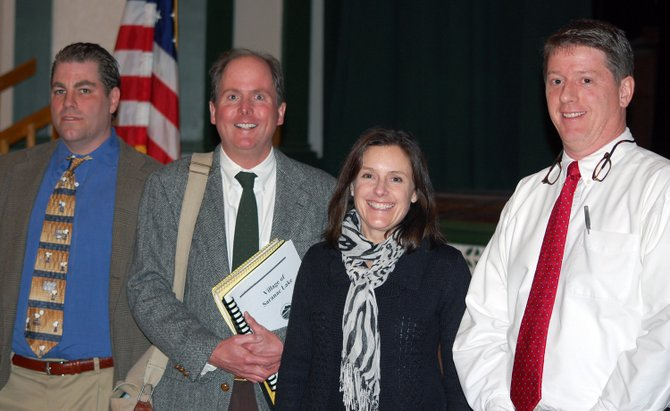 Saranac Lake Village Board of Trustees candidates Mark Gillis, Paul Van Cott, Barbara Rice and Jeff Branch at the Meet the Candidates Forum at the Harrietstown Town Hall March 12.