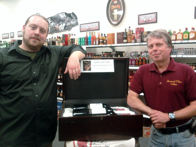 Personal Wine Cellar Manager Ernie Darrah, left, and Owner Brian Craig had petitioned the Schenectady County Legislature to ease restrictions placed on holiday alcohol sales. On Tuesday, March 13, the legislature unanimously approved the change.