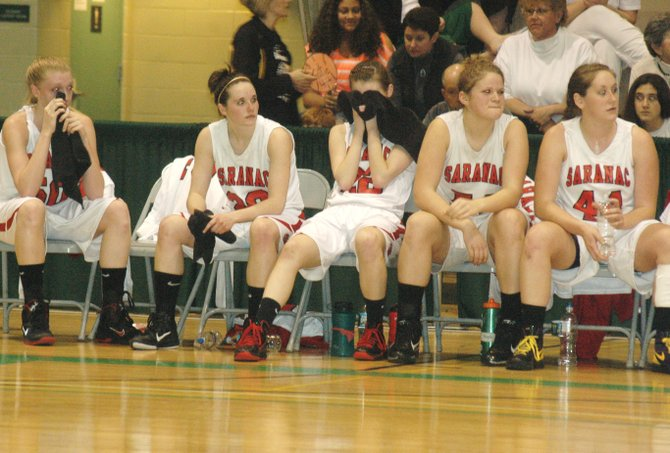 Saranac seniors Stephanie Linder, Alisha Ducatte, Morgan Maye, Victoria Phaneuf and Katie Gates watch during the final minutes of the Lady Chiefs loss against Irvington.