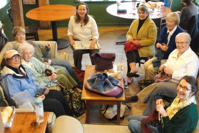 Knitting club members Cathy Travis, Irene Ryan, Cheryl Dunn, Deb Featherman, Adele Truelson, Joanne Niebank, Alice Craw and Olga Diefendorf work on their latest patterns and catch up on local happeings in Common Grounds on March 14. The group recently made a donation to Project Café.
