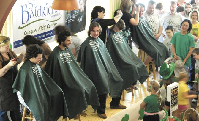 Members of the Morrisville State College lacrosse team get their heads shaved at the St. Baldrick's fundraising event Sunday, March 18, at St. James Episcopal Church in Skaneateles. The event raised more than $21,000 for childhood cancer research.